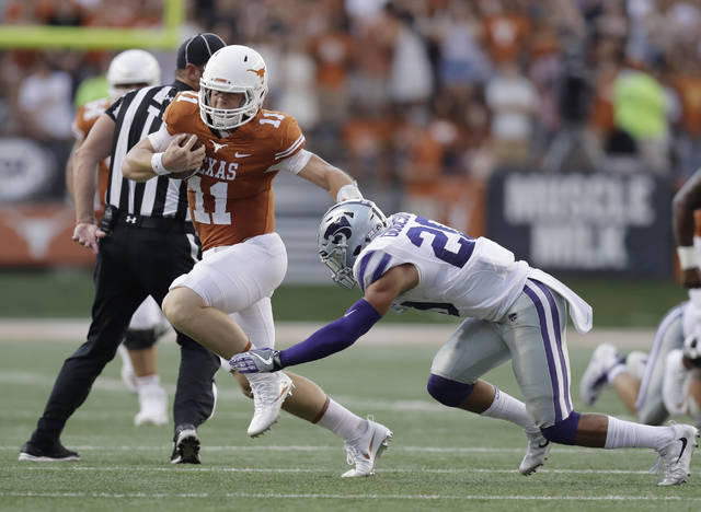 FILE - In this Oct. 7, 2017, file photo, Texas quarterback Sam Ehlinger (11) runs around Kansas State defensive back Denzel Goolsby (20) during the first half of an NCAA college football game, in Austin, Texas. With a tough running style that break tackles and drives defensive backs to the ground, Texas freshman quarterback Sam Ehlinger is sending a message to rival Oklahoma: these Longhorns are tougher than Texas teams of recent past past. (AP Photo/Eric Gay, File)