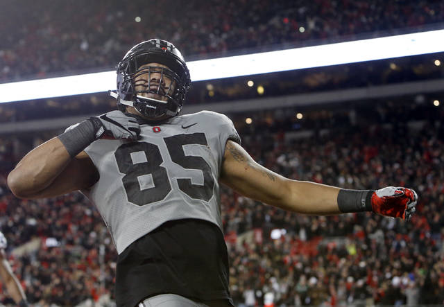 Ohio State tight end Marcus Baugh celebrates his touchdown against Penn State during the second half of an NCAA college football game, Saturday, Oct. 28, 2017, in Columbus, Ohio. Ohio State beat Penn State 39-38. (AP Photo/Jay LaPrete)
