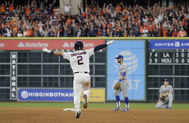 Houston Astros' Alex Bregman reacts after hitting in the game-winning run during the 10th inning of Game 5 of baseball's World Series against the Los Angeles Dodgers Monday, Oct. 30, 2017, in Houston. The Astros won 13-12 to take a 3-2 lead in the series. (AP Photo/David J. Phillip)