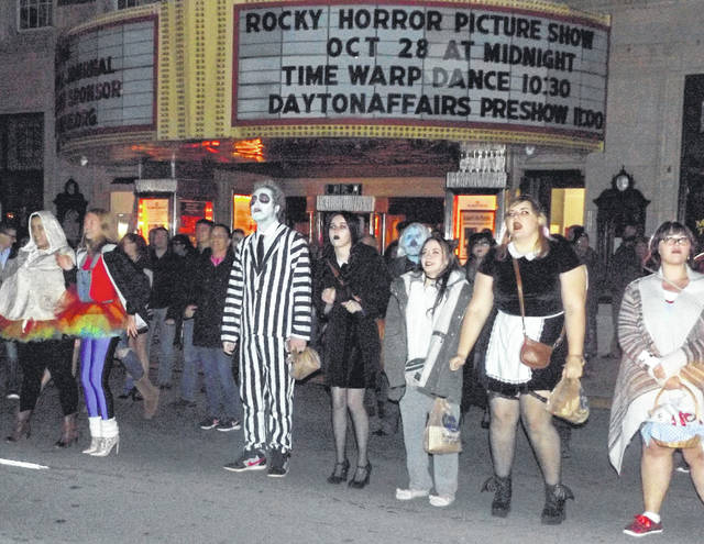 Fans of the The Rocky Horror Picture Show did the Time Warp dance on a closed Main Street in front of the Murphy Theatre Saturday night. The dance precedes the annual midnight showing of the cult movie classic.