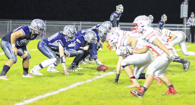 Blanchester's offensive line and East Clinton's defensive line at the snap of the ball during Friday night's game at Barbour Memorial Field.