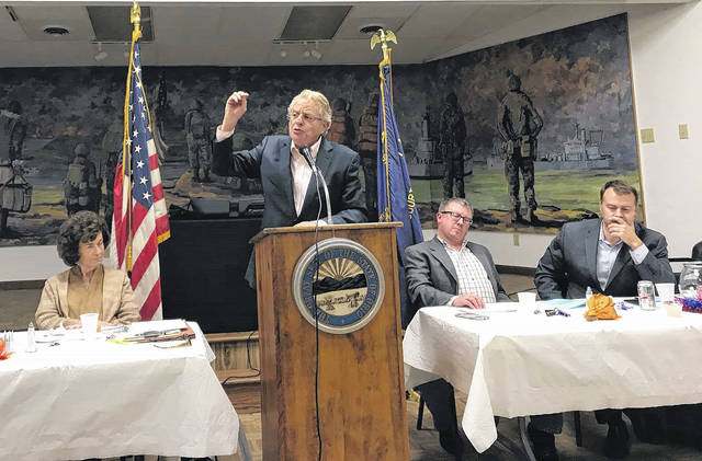 Popular television host Jerry Springer (at the podium) spoke in front of a large crowd Tuesday night at the Fayette County Democratic Party's Fall Dinner. To the left of Springer is Judy Craig, Democratic Executive Committee Chairperson, and to the right is vice chair Chad White and David Pepper, chairman of the Ohio Democratic Party.
