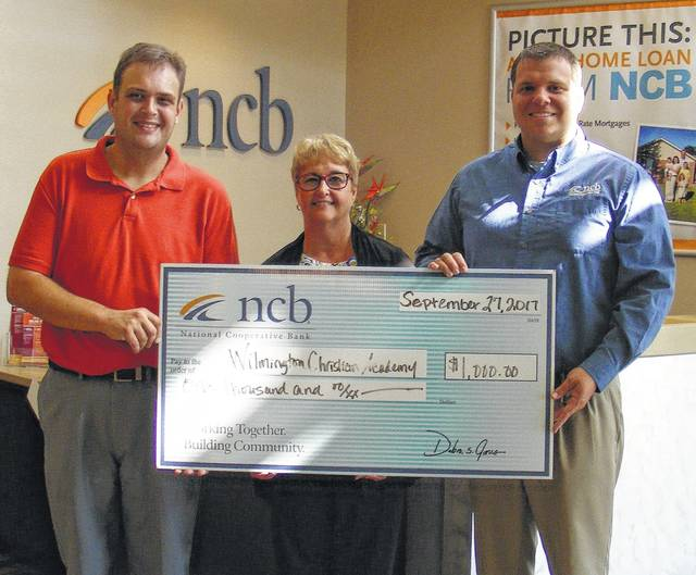 NCB recently donated $1,000 to the Wilmington Christian Academy. The money will be used for new student desks as the school continues to grow. Pictured are Matt Black, WCA Administrator; Tammy Irvin, NCB Regional Branch Manager; and Bryan Smith, NCB Loan Officer.