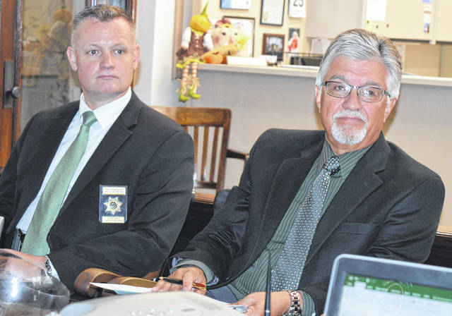 """From left, Clinton County Common Pleas Bailiff Kelly Hopkins and Clinton County Common Pleas Judge John W. """"Tim"""" Rudduck await the start of their Wednesday appointment with county commissioners."""