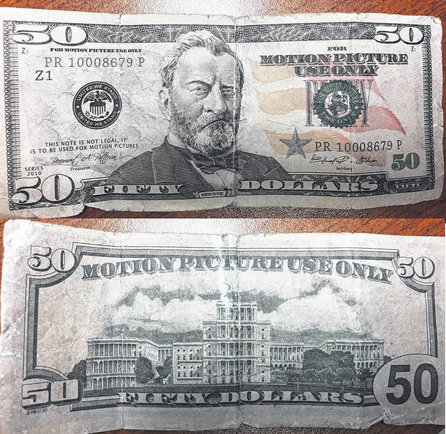 """This counterfeit bill, meant to be used as a prop in a film, says """"For motion picture use only."""" It was recently passed at Flagway in Hillsboro."""