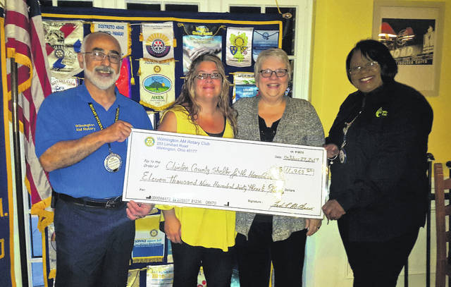 AM Rotary presents a check for $11,963 to the Clinton County Homeless Shelter Friday at the club's weekly meeting at the General Denver. From left are Rotarian Fadi Al-Ghawi, Amber Taylor and Nancy McCormick representing the shelter, and Rotary's Cardboard City Chair Sigrid Solomon.