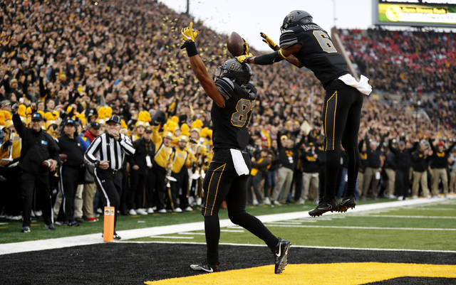 Iowa tight end Noah Fant (87) celebrates with teammate Ihmir Smith-Marsette after catching a 3-yard touchdown pass during the first half of an NCAA college football game against Ohio State, Saturday, Nov. 4, 2017, in Iowa City, Iowa. (AP Photo/Charlie Neibergall)