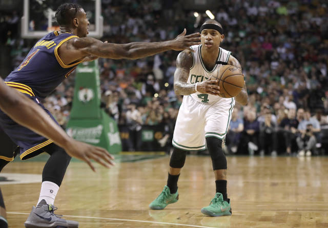 FILE - In this Friday, May 19, 2017 file photo, Boston Celtics guard Isaiah Thomas looks to pass the ball as Cleveland Cavaliers guard Iman Shumpert, left, defends during the first half of Game 2 of the NBA basketball Eastern Conference finals in Boston. Day by day, Isaiah Thomas looks a little more like an All-Star point guard like himself. And just maybe like one who can rescue the reeling Cavaliers. Thomas has been increasing his workout load and is making strong progress in his recovery from a hip injury that ended his 2016 in Boston and delayed the start of his 2017 season with Cleveland, Tuesday, Nov. 7, 2017. (AP Photo/Elise Amendola, File)