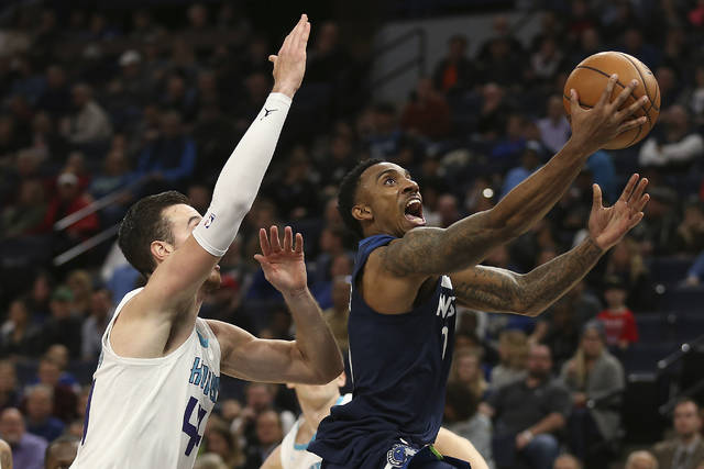 Minnesota Timberwolves guard Jeff Teague, right, pushes up to the basket past Charlotte Hornets forward Frank Kaminsky (44) in the first half of an NBA basketball game, Sunday, Nov. 5, 2017, in Minneapolis. (AP Photo/Stacy Bengs)