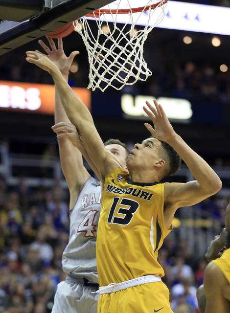FILE - In this Oct. 22, 2017, file photo, Missouri forward Michael Porter Jr. rebounds during the first half of an exhibition NCAA college basketball game against Kansas in Kansas City, Mo. Porter faces the burden of trying to help turn around a Missouri program that has finished in the Southeastern Conference basement each of the last three years. (AP Photo/Orlin Wagner, File)
