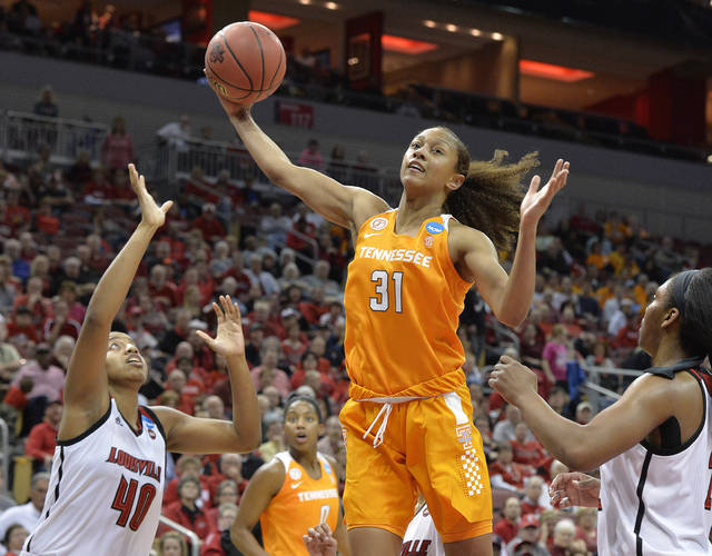 """FILE - In this March 20, 2017, file photo, Tennessee's Jaime Nared (31) grabs a rebound between Louisville's Ciera Johnson (40) and Myisha Hines-Allen (2) during an NCAA women's college basketball tournament game in Louisville, Ky. Nared was caught off guard this year when a teammate called her a """"mother figure,"""" but that's a role she's filling as one of the lone seniors on a freshman-laden team. (AP Photo/Timothy D. Easley, File)"""