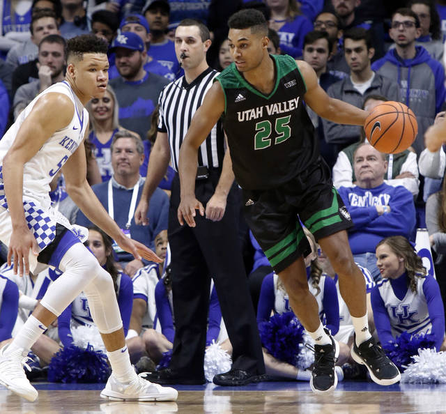 Utah Valley's Kenneth Ogbe (25) looks for an opening on Kentucky's Kevin Knox (5) during the first half of an NCAA college basketball game, Friday, Nov. 10, 2017, in Lexington, Ky. (AP Photo/James Crisp)