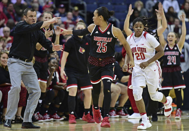 Louisville's Asia Durr celebrates after a three point basket with head coach Jeff Walz during overtime of an NCAA college basketball game against Ohio State, Sunday, Nov. 12, 2017, in Columbus, Ohio. Louisville won 95-90 in overtime. (AP Photo/David Dermer)