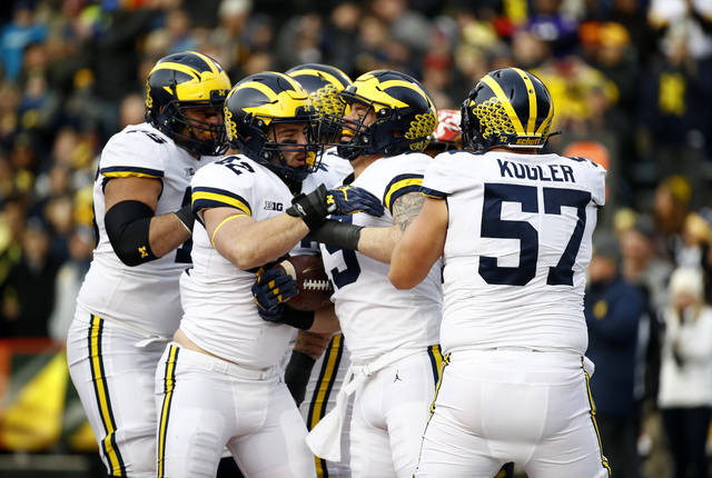 Michigan fullback Henry Poggi, second from right, celebrates his touchdown with teammates in the first half of an NCAA college football game against Maryland in College Park, Md., Saturday, Nov. 11, 2017. (AP Photo/Patrick Semansky)