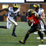 Michigan aims to spoil seasons for Wisconsin and Ohio State