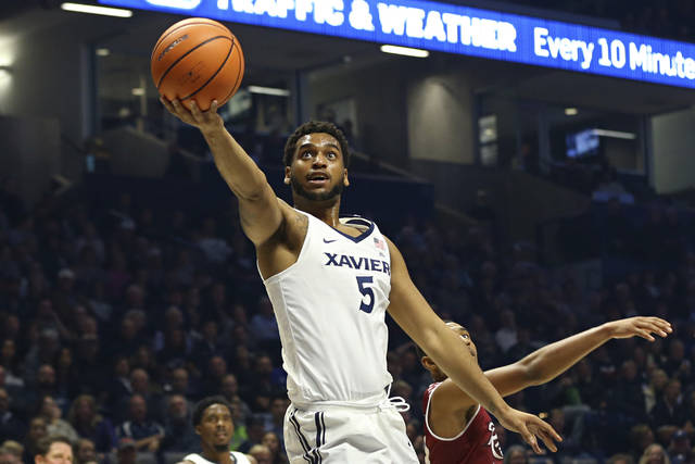 Xavier guard Trevon Bluiett drives to the basket against Rider during the first half of an NCAA college basketball game, Monday, Nov. 13, 2017, in Cincinnati. Xavier won 101-75. (AP Photo/Aaron Doster)