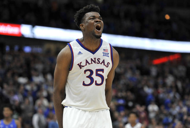 Kansas' Udoka Azubuike yells after his team scored late in the second half of an NCAA college basketball game against Kentucky Tuesday, Nov. 14, 2017, in Chicago. Kansas won 65-61. (AP Photo/Paul Beaty)