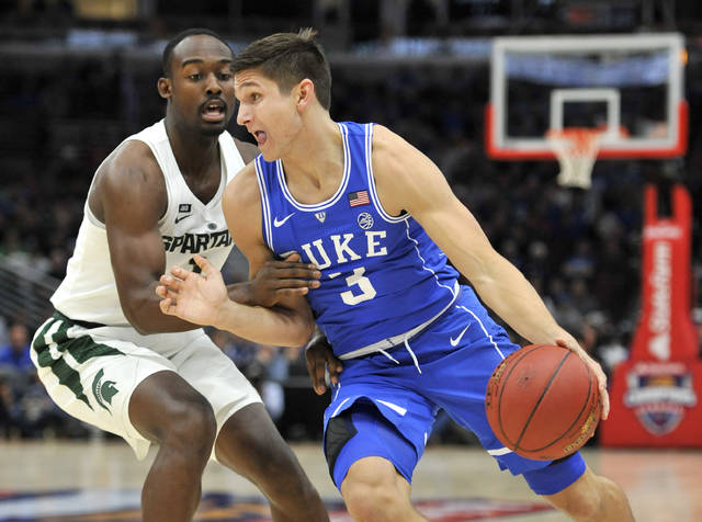 Duke guard Grayson Allen (3) drives on Michigan State guard Joshua Langford during the first half of an NCAA college basketball game Tuesday, Nov. 14, 2017, in Chicago. (AP Photo/Paul Beaty)