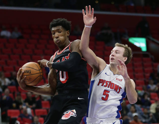Miami Heat forward Josh Richardson (0) grabs a rebound against Detroit Pistons guard Luke Kennard (5) during the second half of an NBA basketball game Sunday, Nov. 12, 2017, in Detroit. The Pistons defeated the Heat 112-103. (AP Photo/Duane Burleson)