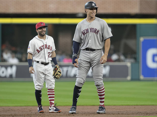 FILE - In this July 2, 2017, file photo, New York Yankees' Aaron Judge, right, and Houston Astros second baseman Jose Altuve have a conversation during the first inning of a baseball game in Houston. Altuve and Judge are the favorites for the AL MVP award, to be announced Thursday, Nov. 16, 2017. (Yi-Chin Lee/Houston Chronicle via AP, File)