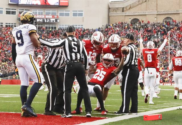 Wisconsin's Derrick Tindal is congratulated after recovering a fumble near the goal line during the first half of an NCAA college football game against the MichiganSaturday, Nov. 18, 2017, in Madison, Wis. (AP Photo/Morry Gash)
