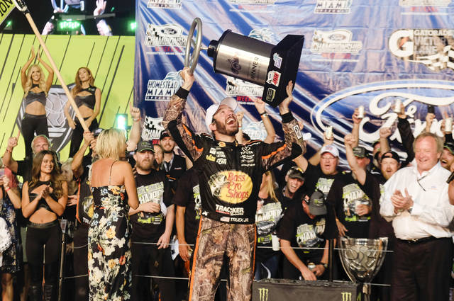 Martin Truex Jr. celebrates in Victory Lane after winning a NASCAR Cup Series auto race at Homestead-Miami Speedway in Homestead, Fla., Sunday, Nov. 19, 2017. (AP Photo/Gaston De Cardenas)