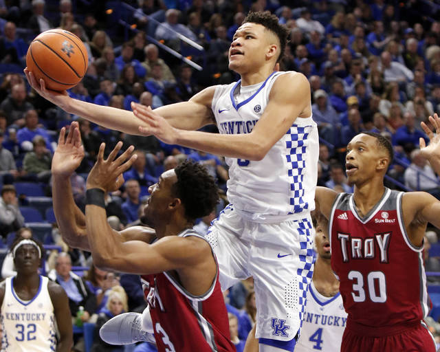 Kentucky's Kevin Knox, center, shoots between Troy's Wesley Person (3) and Alex Hicks (30) during the second half of an NCAA college basketball game, Monday, Nov. 20, 2017, in Lexington, Ky. (AP Photo/James Crisp)