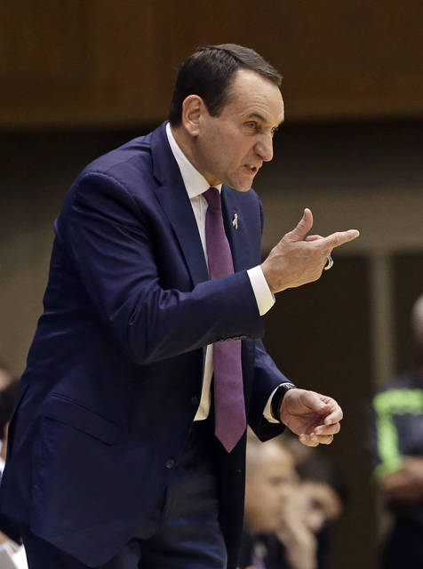 Duke head coach Mike Krzyzewski speaks with an official during the first half of an NCAA college basketball game against Furman in Durham, N.C., Monday, Nov. 20, 2017. (AP Photo/Gerry Broome)