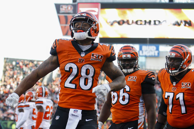 Cincinnati Bengals running back Joe Mixon (28) celebrates after scoring a touchdown in the second half of an NFL football game against the Cleveland Browns, Sunday, Nov. 26, 2017, in Cincinnati. (AP Photo/Frank Victores)