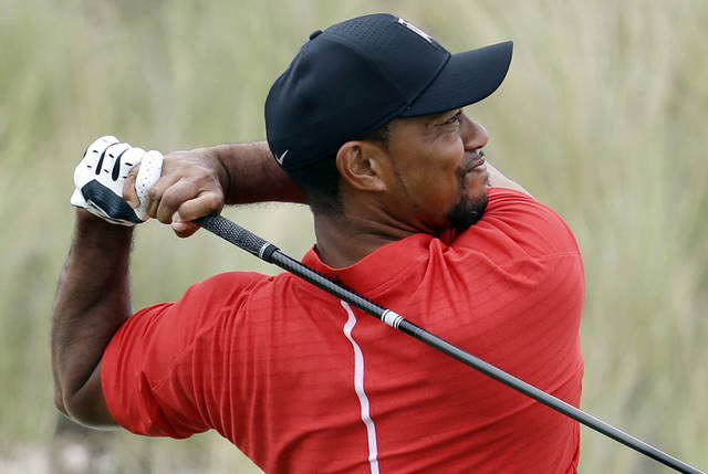 FILE - In this Dec. 4, 2016, file photo, Tiger Woods watches his tee shot on the third hole during the final round at the Hero World Challenge golf tournament in Nassau, Bahamas. Woods returns this week to the Hero World Challenge in the Bahamas. It's the 10th time he has returned after a layoff of 10 week or longer. (AP Photo/Lynne Sladky, File)
