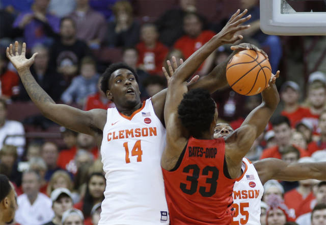 Clemson's Elijah Thomas, left, blocks the shot of Ohio State's Keita Bates-Diop during the first half of an NCAA college basketball game Wednesday, Nov. 29, 2017, in Columbus, Ohio. (AP Photo/Jay LaPrete)