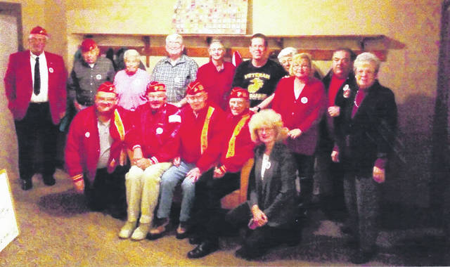 Members of Marine Corps League Detachment 995 and guests at the Marine Corps' 242nd birthday celebration at McD's Pub are, from left: bottom row, Gene Wilt, Dean Waddell, Bob Caldwell, Jack Williams, and Vicki Wilson; top, Commandant Greg Schultz, John and Darlene Woodmansee, George Mitchell, Barb and Rob Caldwell, Liz Waddell, Rose Ann and David West, and Beverly Caldwell.