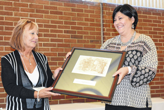 Stephenie Eriksson (right) is pictured with her nominator, Judy Harvey, assistant professor of English, at the award ceremony.