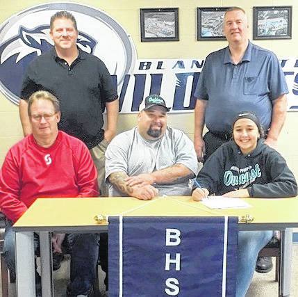 Blanchester High School senior Hannah Mann has signed to play softball in college at Sinclair Community College. In the photo, from left to right, front row, seated, Steve Beachler, head coach at Sinclair Community College; Robert Mann, Hannah's father; Hannah Mann; back row, standing, Steve Wilson, head coach Outcast 18u Black fast-pitch team; and Jamey Grogg, head coach BHS softball.