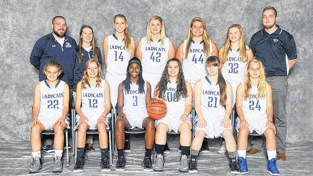 The Blanchester High School girls basketball team, from left to right, front row, Savanna Shank (22), Holly Scott (12), Asia Baldwin (3), Shelbie Rose (00), Elecia Patton (21), Lana Roy (24); back row, coach Bradon Pyle, coach Elyse Pyle, Olivia Gundler (14), Dakota Watters (42), Regan Ostermeier (44), Casey Kingsland (32), coach Zane Bolin