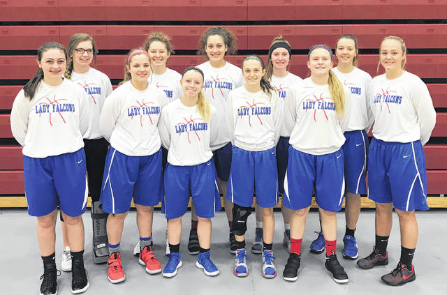 The Clinton-Massie varsity girls basketball team, from left to right, front row, Abbey Faucett, Hannah Doss, Emily Ireland, McKenna Crawford, McKenzie Avery, Faith Cottrell; back row, Haley Conley, Maggie Williams, Johanna Theetge, Alana Smith, Nina Lazic. Team member Patience Chowning was not present for the photo.