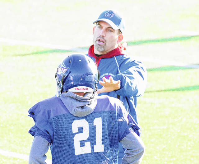 Massie defensive coordinator Scott Rolf (right) will have his defense focused on the multi-faceted Wyoming offense come Friday night.