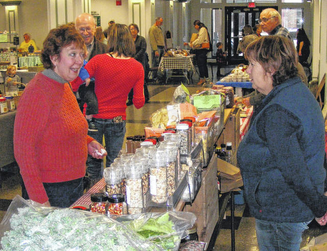 It's warm inside as local residents and vendors gather indoors at the Clinton County Winter Farmers Market Saturdays 9 a.m.-noon at the Wilmington City Building. Vendors offer seasonal vegetables, locally grown beef, home baked goods, home baked breads and rolls, fudge, homemade doggie and cat treats, locally made pottery, arts and craft items.