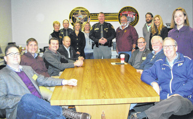 It was Government Day for Leadership Clinton Class of 2018 on Thursday as they toured the county courthouse and the county jail, and heard from several government and law enforcement leaders at both facilities as well as at the American Legion post. Sitting, clockwise from left, are Matt Wahrhaftig, Kevin Abt, Jim Barnett, Gene Coffman, Dan Evers, Brad Reynolds and Tom Barr. Standing from left are Pam McCoy, Col. Brian Pickett of the Clinton County Sheriff's Office, Kristi Fickert, Susan Valentine-Scott, CCSO Captain Justin Drake, Richard James, Eric Guindon, Carrie Zeigler and Kelsey Swindler.