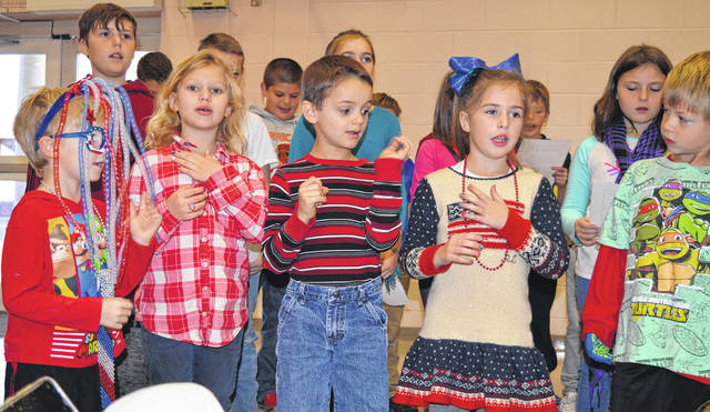 East End Elementary School students on Friday recite a poem for their schoolmates, parents and grandparents, but even more so for local veterans attending a special school assembly the day before Veterans Day. Veterans attending also received goodie bags. For more photos of the event, please see wnewsj.com.