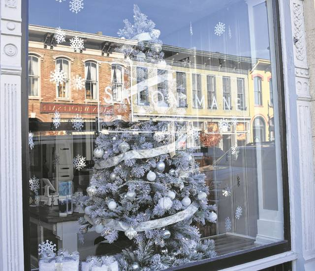 """Salon Mane, the Murphy Theatre, and South Street Wine Cellar are among the local businesses taking part in the 2017 Downtown Window Decorating Contest. The winner of this year's theme """"There's No Place Like Home for the Holidays"""" will be announced during the Hometown HoliDazzle on Saturday."""