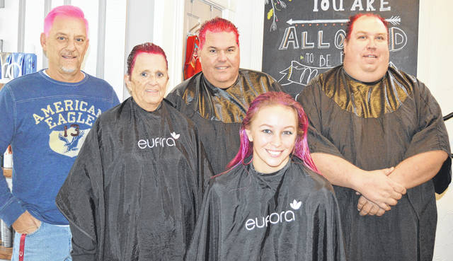 More than $1,000 was collected for the organization Jamestown Families Cancer Care as a challenge issued on Jeffersonville radio station WZAA 106.9 FM. Several people promised to color their hair pink if $1,000 were raised, and they posed at Salon Mane in downtown Wilmington where much of the coloring was done. From left are Jim Curtis, Becky Patrick, Charlie Hargrave, Kaylie Goins and Dave Hurst.