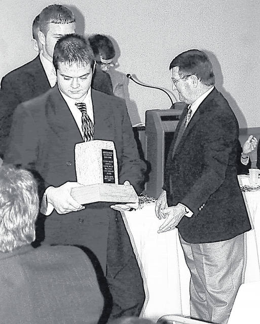Blanchester's Cheyenne Duggins (left) accepts the Lombardi Award from keynote speaker Tony Lamke (right) at the annual banquet in 2000. Duggins and Brad Sanders were the BHS nominees that year while nominees from the other schools included Jarrod Rich and Nick Sandlin of Clinton-Massie; Steve Olds and Matt Terrell of East Clinton; Ben Schaad and Tyler Steele of Wilmington.