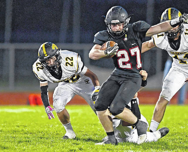 Jonathan Alder's Jamie Dye (27) leads the Pioneers' offense with 1,412 yards and 15 touchdowns on the ground.