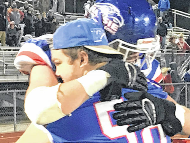 Chris Rowe (58) was injured early in the season and has not played since. It was an emotional time for the senior offensive lineman following Clinton-Massie's 28-7 win over Wyoming last week in the Region 16 championship game.