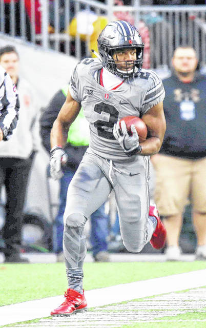 Freshman running back J.K. Dobbins carried the ball four times for 47 yards in the first quarter against Iowa, then got two carries for four yards the rest of the game.