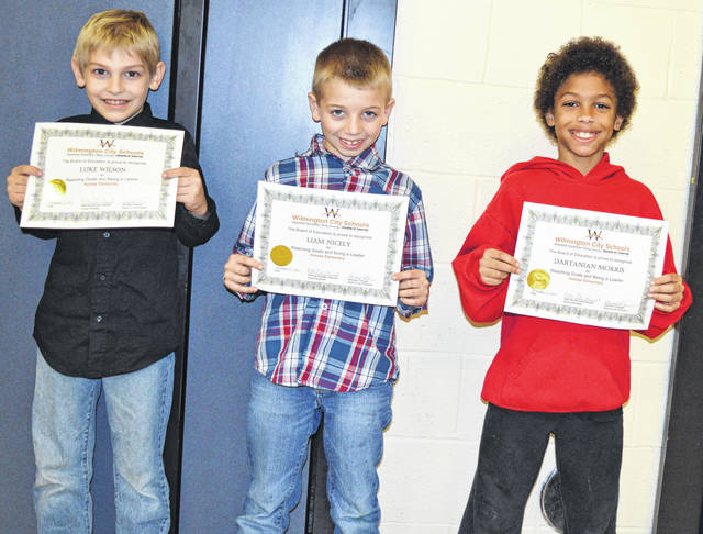 Three Holmes Elementary students earned recognition at the WCS school board meeting. From left are Luke Wilson, Liam Nicely and Dartanian Morris.