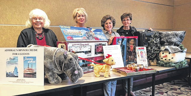 The Health Alliance of Clinton County is preparing for its annual Holiday Ball and Charity Auction. The Ball takes place at 6 p.m. Saturday, Dec.2 at the Roberts Centre. All auction proceeds go to the Cancer Patient Assistance Program which serves cancer patients in Clinton County. The annual event hosts a delicious dinner, stunning Christmas decorations, a silent and live auction, and dancing to the band Laika. Reservations are available to the public by calling 937-218-2600. Shown with some of the auction items are: Jennifer Hollon, Ball co-chair; Patti Cook, Auction co-chair; Ann Johnson, Ball co-chair; and Susan Kocher, Auction co-chair.
