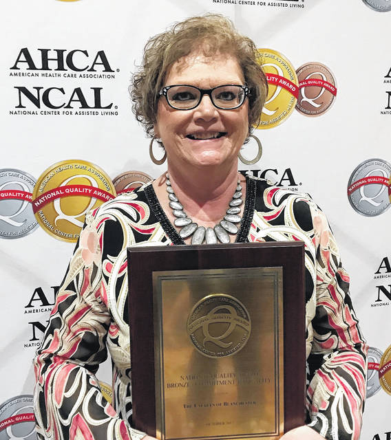 Laurels of Blanchester Administrator Lori Byrom accepts the national award.