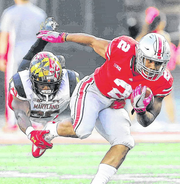 Ohio State running back J.K. Dobbins tries to get out of the grasp Maryland DB Antoine Brooks, Jr. on a second quarter run at Ohio Stadium in a game earlier this season.
